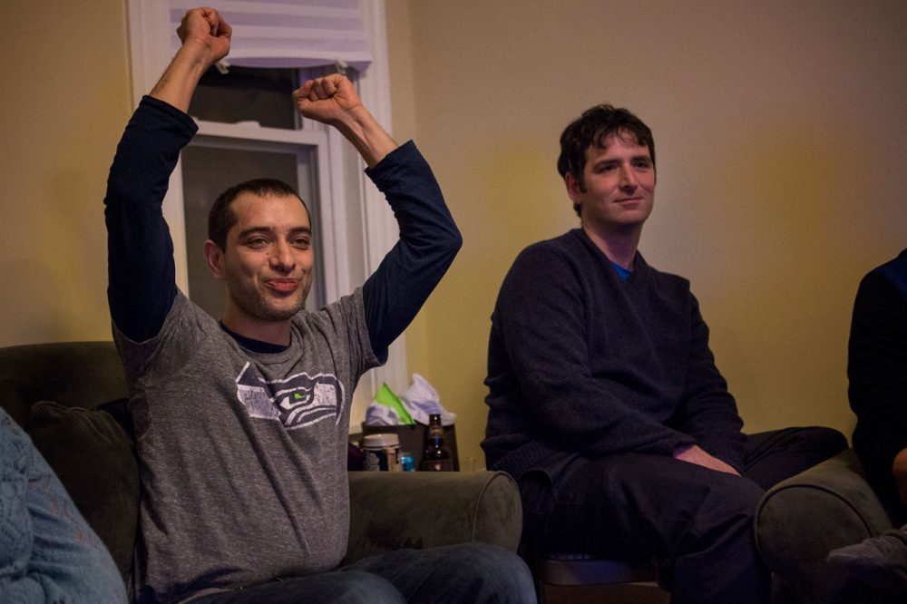 Navad Tanners, left, has called Boston home for seven years but grew up in Spokane, Washington.  He hosted a dozen friends for Sunday's Super Bowl game. (Jesse Costa/WBUR)