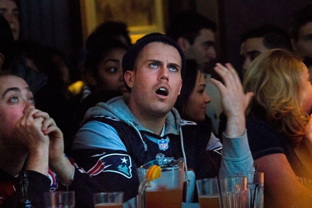 A Patriots fan watches inside the Cask 'n Flagon. (Jesse Costa/WBUR)