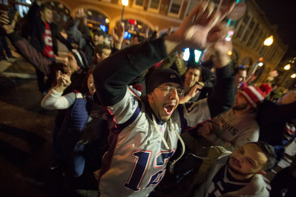 Fans celebrate the Patriots win on Brookline Ave. (Jesse Costa/WBUR)