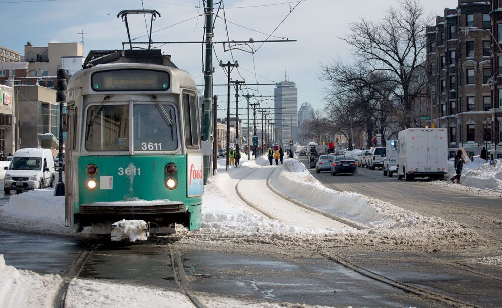 A Green Line trolley runs down Commonwealth Avenue in Boston this past winter. (Robin Lubbock/WBUR)