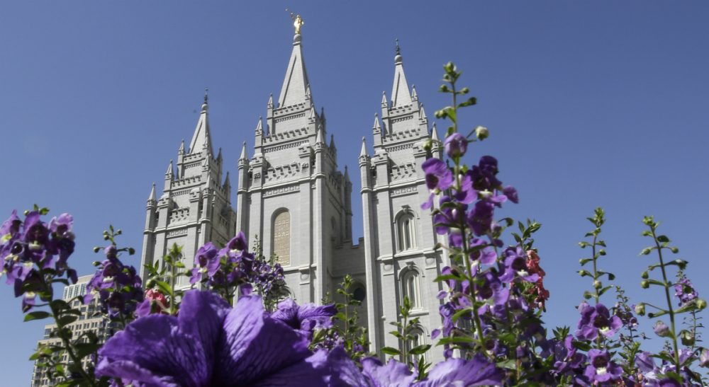 "In this Sept. 3, 2014 photo, flowers bloom in front of the Salt Lake Temple. Mormon church leaders are making a national appeal for a ""balanced approach"" in the clash between gay rights and religious freedom. The church is promising to support some housing and job protections for gays and lesbians in exchange for legal protections for believers who object to the behavior of others. (Rick Bowmer/AP)"