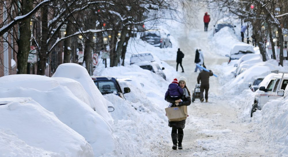 With all the snow lately, many of us have grappled with how to get to and from work. Some, more than others. In this photo, a woman carries a toddler in Boston, Tuesday, Feb. 3, 2015. The area has received about 40 inches of snow in the past week. (Charles Krupa/AP)