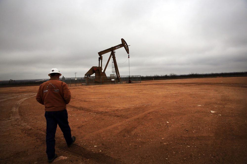 An oil well owned an operated by Apache Corporation in the Permian Basin are viewed on February 5, 2015 in Garden City, Texas. The well produces about 55-70 barrels of oil per day. As crude oil prices have fallen nearly 60 percent globally, many American communities that became dependent on oil revenue are preparing for hard times. Texas, which benefited from hydraulic fracturing and the shale drilling revolution, tripled its production of oil in the last five years. The Texan economy saw hundreds of billions of dollars come into the state before the global plunge in prices. Across the state drilling budgets are being slashed and companies are notifying workers of upcoming layoffs. According to federal labor statistics, around 300,000 people work in the Texas oil and gas industry, 50 percent more than four years ago. (Spencer Platt/Getty Images)