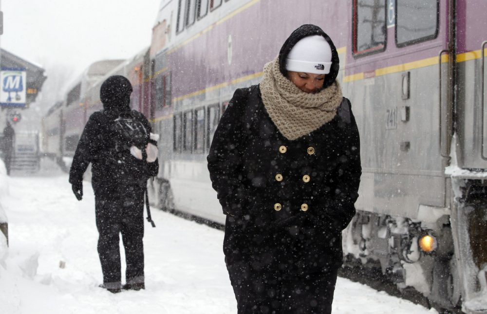 Passengers wait at the commuter rail train station Monday in Framingham.