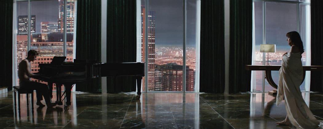 "Jamie Dornan and Dakota Johnson as Christian Grey and Anastasia Steele in ""50 Shades of Grey."" (Courtesy Universal Studios)"