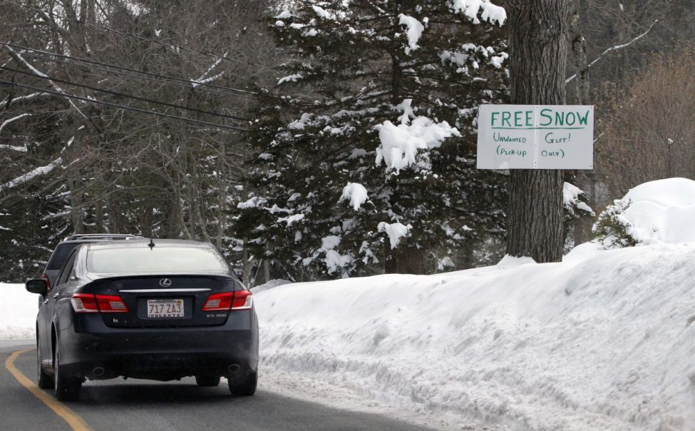 A sign in a Weston resident's front yard offers free snow on Wednesday. Another storm is forecast to bring more snow to the state this weekend. (Bill Sikes/AP)