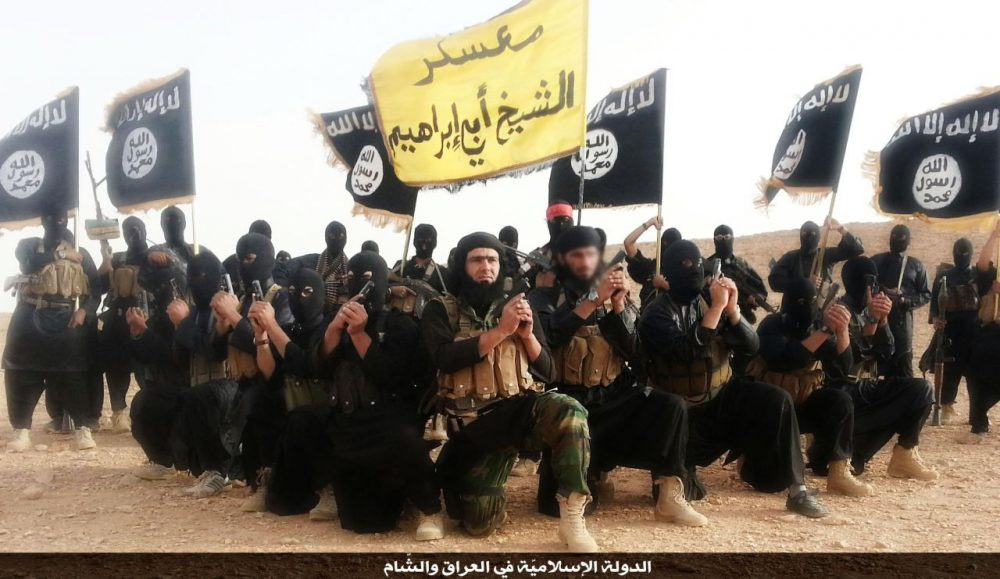 A promotional image of members of the group that calls itself the Islamic State (ISIS), taken in Anbar province in 2014.(Wikimedia Commons)