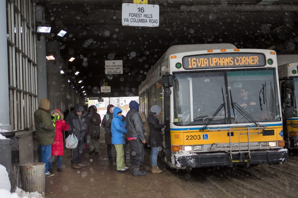 Commuters get on the 16 bus to Forest Hills at Andrew Square station Tuesday. (Jesse Costa/WBUR)