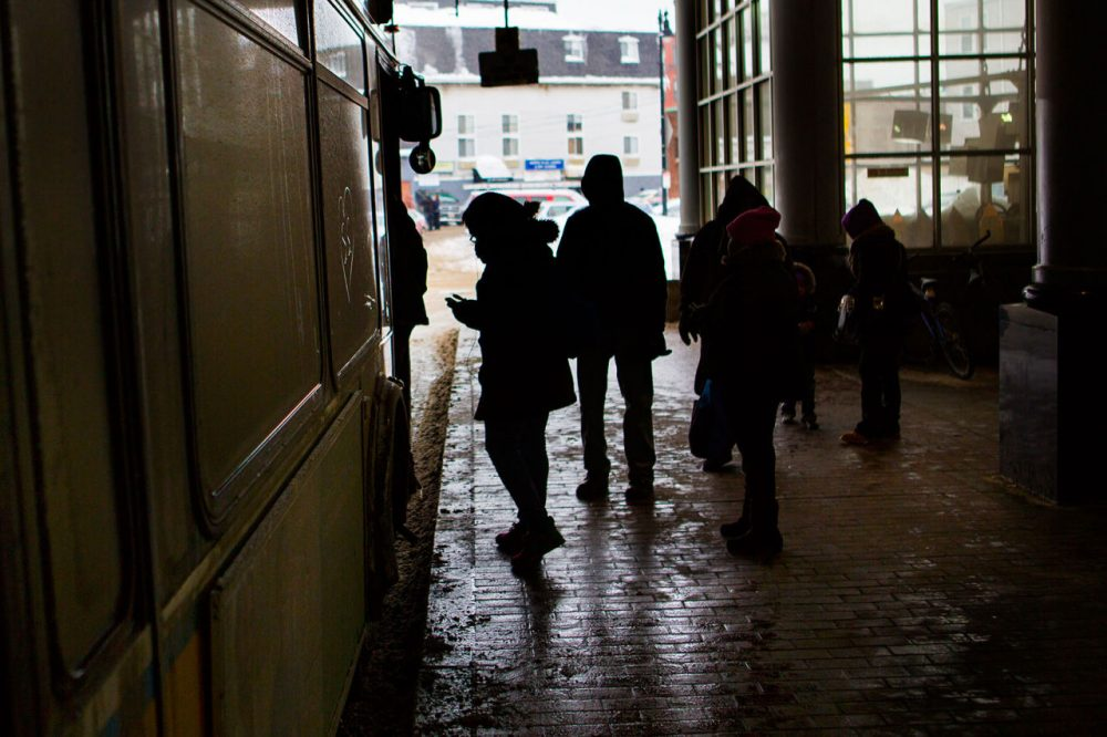 MBTA Commuters board the 17 bus to Fields Corner. (Jesse Costa/WBUR)