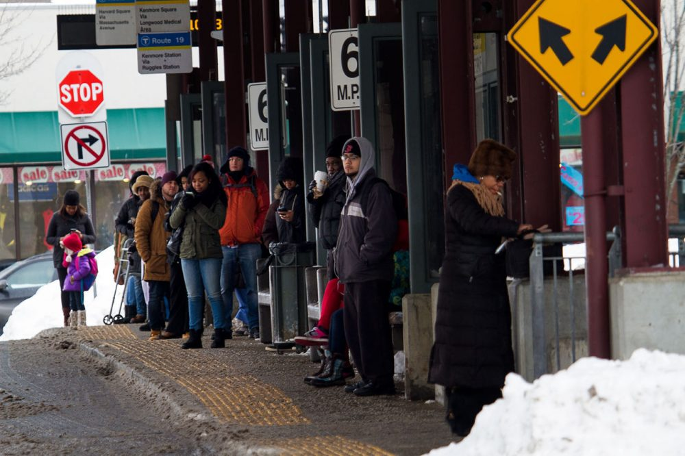 Commuters wait for buses at Dudley MBTA Station. (Jesse Costa/WBUR)