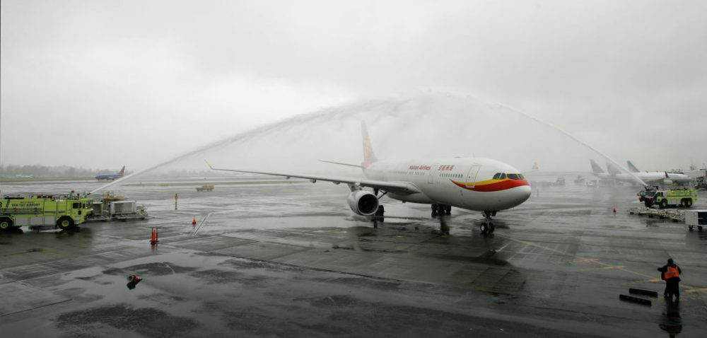 In this 2008 file photo, a Hainan Airlines Airbus A330-200 airplane is given a water salute as it arrives at Seattle-Tacoma International Airport. Hainan will begin Boston to Shanghai nonstop flights in June. (Ted S. Warren/AP)