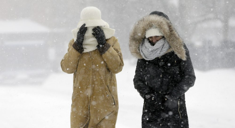 In this photo, pedestrians walk bundled against the blowing snow during a winter snowstorm, Tuesday, Jan. 27, 2015, in Boston. A blizzard heaped snow on Boston, the rest of eastern Massachusetts and parts of Long Island on Tuesday, delivering wind gusts topping 75 mph, but it failed to live up to the hype farther south in Philadelphia and New York City. (Steven Senne/AP)