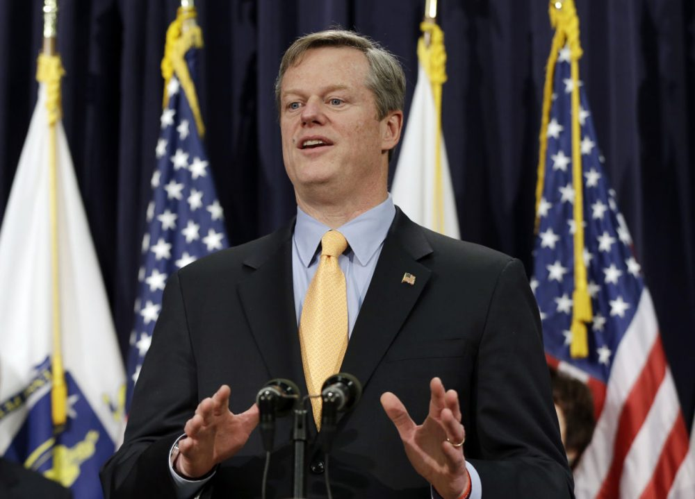 Gov. Charlie Baker speaks at a news conference in Boston Friday, where he named a seven-member panel of experts in transportation, economic development and municipal planning to come up with a fix for the troubled MBTA. (Elise Amendola/AP)