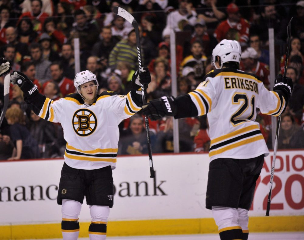 Bruins' Tony Krug (47), celebrates with teammate Loui Eriksson (21), after Eriksson scored a goal during the first period Sunday. (Paul Beaty/AP)