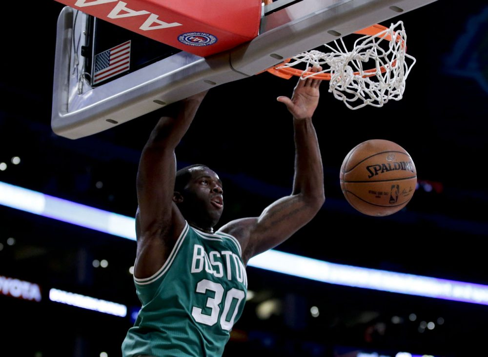 Celtics center Brandon Bass scores against the Lakers during the first half of Sunday's game in Los Angeles. (Chris Carlson/AP)