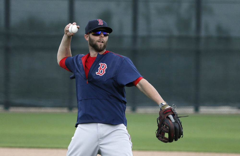 Boston Red Sox's Dustin Pedroia makes a throw to first as he participates in infielder drills at baseball spring training in Fort Myers Fla., Monday. (Tony Gutierrez/AP)