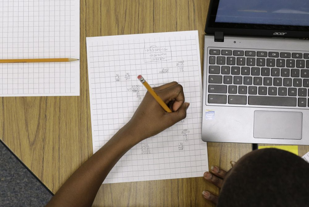 In this Feb. 12, 2015 photo, Yamarko Brown, age 12, works on math problems as part of a trial run of a new state assessment test at Annapolis Middle School in Annapolis, Md. (Patrick Semansky/AP)