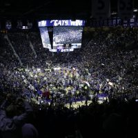 Kansas State fans rushed the floor after upsetting Kansas 70-63. One of the fans was cited for disorderly conduct after body-checking Kansas' Jamari Traylor. (AP Photo/Orlin Wagner)
