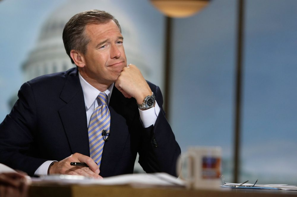 """Moderator Brian Williams watches a video which pays tribute to late moderator Tim Russert during a taping of """"Meet the Press"""" at the NBC studios June 22, 2008 in Washington, DC. (Alex Wong/Getty Images for Meet the Press)"""