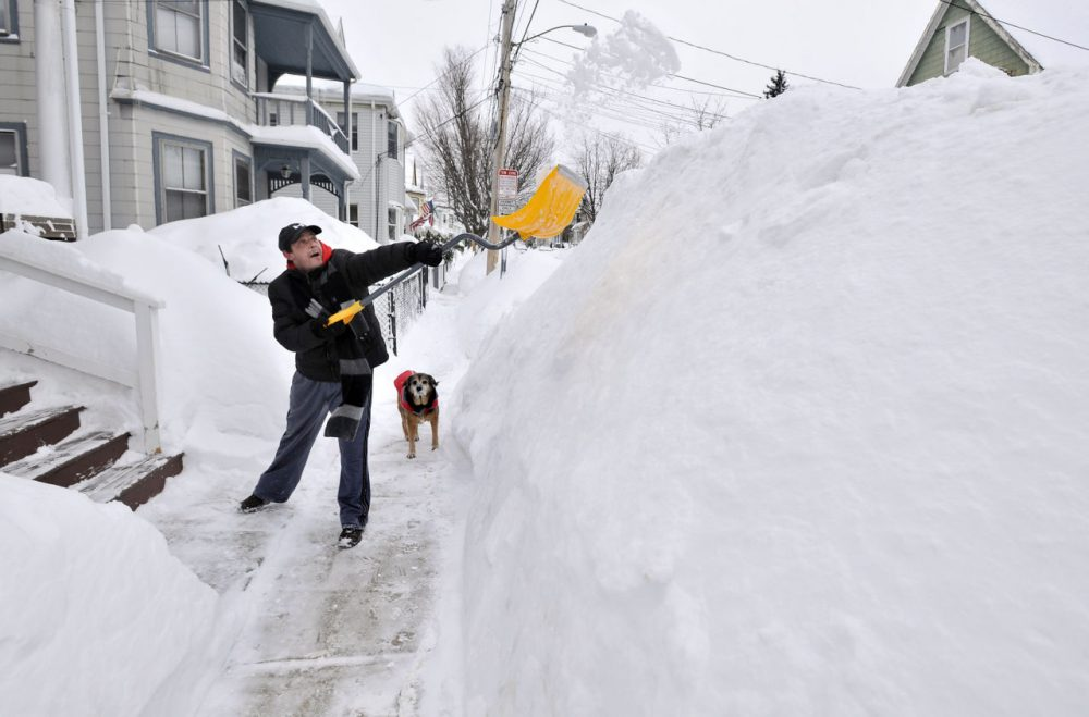 Lee Anderson shoveled in front of his house in Somerville on Feb. 10, 2015, after a storm dumped another two feet of snow and forced the MBTA to suspend all rail service for the day. (Josh Reynolds/AP)
