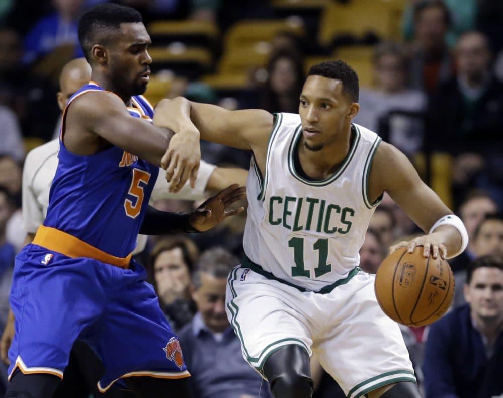 Boston Celtics guard Evan Turner (11) drives against New York Knicks guard Tim Hardaway Jr. (5) during Wednesday night's game in Boston on Feb. 25, 2015. (Elise Amendola/AP)