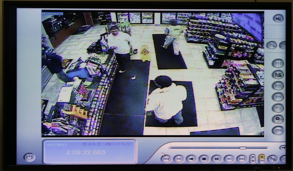 A still image from a courtroom video display shows Aaron Hernandez visiting a gas station about an hour before prosecutors say Odin Lloyd was killed. (Charles Krupa/AP/Pool)