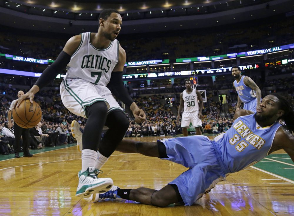 Denver Nuggets forward Kenneth Faried (35) falls to the floor after fouling Boston Celtics forward Jared Sullinger (7) in Wednesday night's game in Boston, Feb. 4, 2015. The Celtics won 104-100. (Elise Amendola/AP)