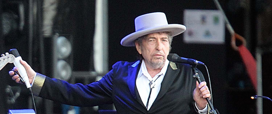 """Bob Dylan performing on stage at """"Les Vieilles Charrues"""" Festival in Carhaix, western France  (AP/David Vincent)."""