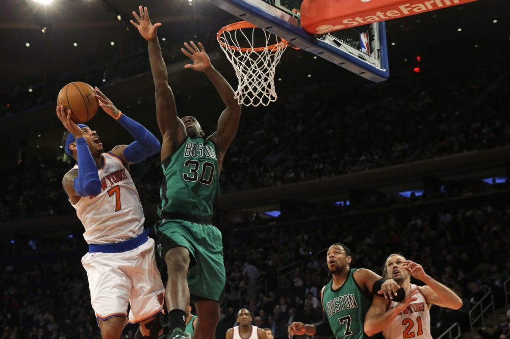 New York Knicks forward Carmelo Anthony (7) goes up against Boston Celtics forward Brandon Bass (30) during Tuesday night's game on Feb. 3, 2015 at Madison Square Garden in New York.  (Mary Altaffer/AP)