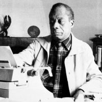 American writer James Baldwin poses in front of his typewriter in his house, March 15, 1983, Saint Paul de Vence, France. (AP)