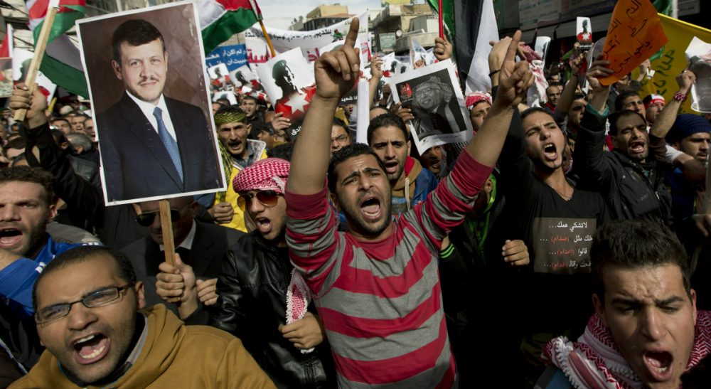 Demonstrators chant anti-Islamic State group slogans and carry posters with pictures of Jordanian King Abdullah II, late King Hussein and slain Jordanian pilot, Lt. Muath al-Kaseasbeh, during an anti-ISIS rally in Amman, Jordan, Friday, Feb. 6, 2015. Several thousand people marched after Muslim Friday prayers in support of the king's pledge of a tough military response to the killing of the pilot. (Nasser Nasser/AP)