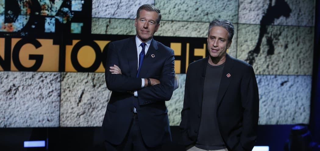 Brian Williams and Jon Stewart at a Hurricane Sandy benefit in 2012. (Heidi Gutman/AP)