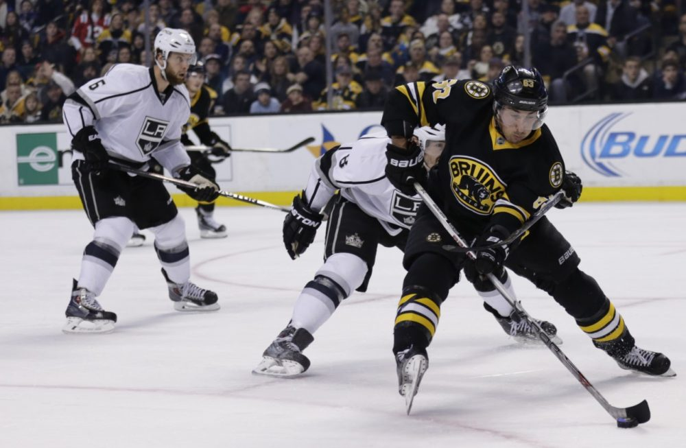 Boston Bruins left wing Brad Marchand (63) skates against the Los Angeles Kings during the second period of an NHL hockey game in Boston Saturday. (Charles Krupa/AP)