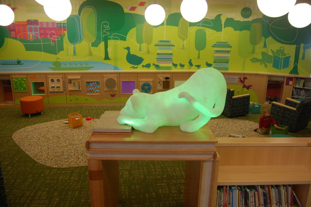 """It has this really cool sensory wall in it,"" Colford says of the Children's Library. ""It's really about tactile and visual and things to stimulate the senses. They're really good for our youngest users and kids with autism or other learning disabilities."" The mural depicts the Boston Public Garden and the avian family from Robert McCloskey's 1941 picture book ""Make Way for Ducklings."" (Greg Cook)"