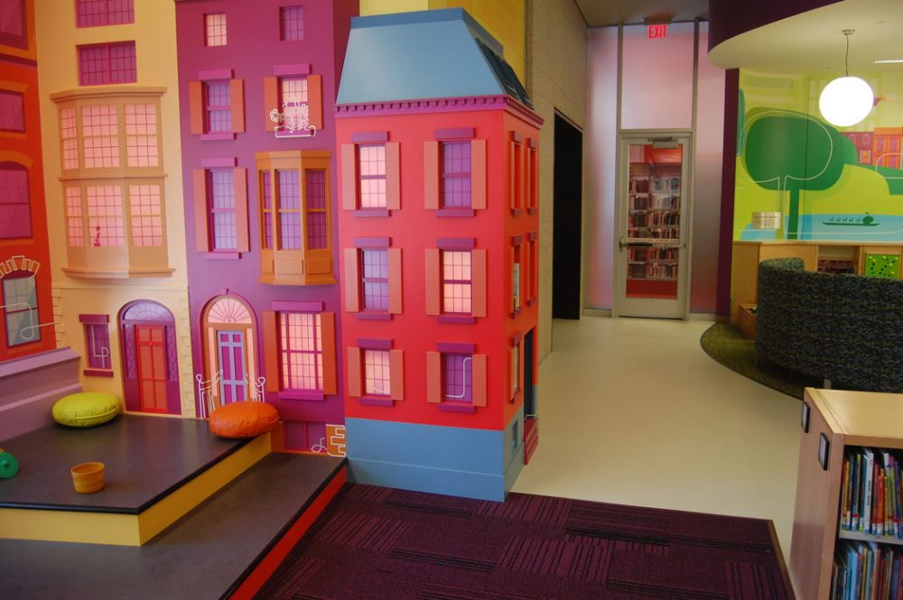 """The StoryScape story hour area is modeled after a Boston neighborhood with brownstones,"" Colford says. These building facades in the Children's Library were created by Mystic Scenic Studios of Norwood. (Greg Cook)"