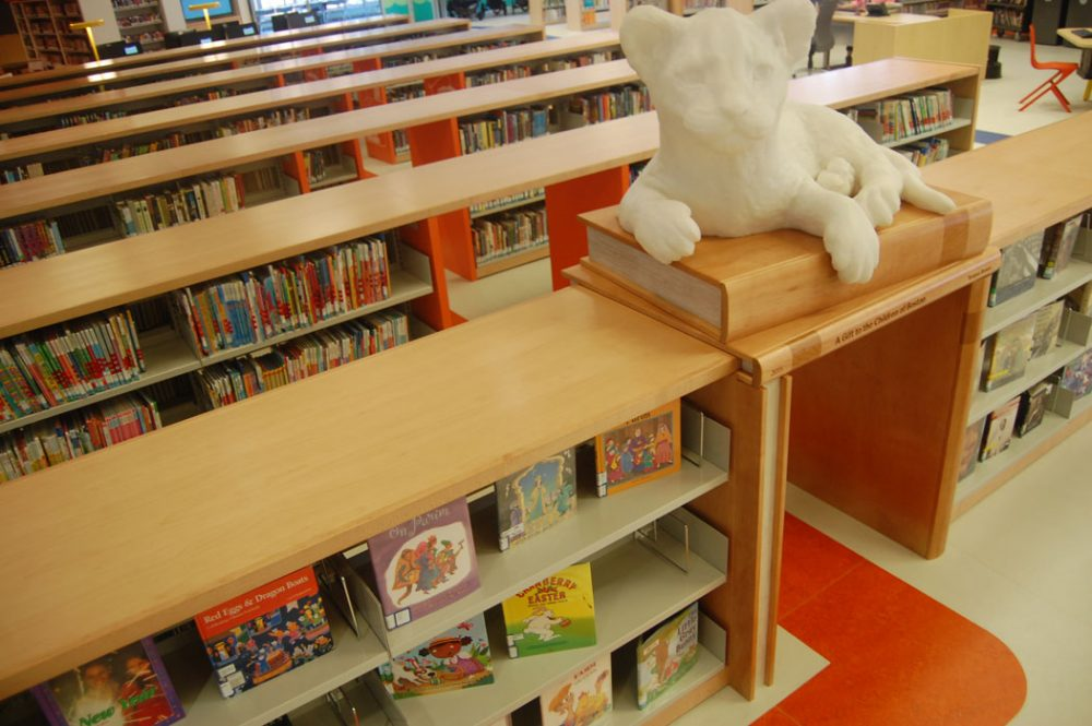 """The lion cubs, this is a direct nod to the McKim Building,"" Colford says of the Children's Library. They were designed by 42 Design Fab of Springfield. ""Each one of them is sitting on or reading a book. In resting mode, they rotate through all the colors. They're programmed so that as kids approach them or go under them, they light up in different ways."" (Greg Cook)"
