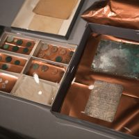 Coins and the engraved silver plaque found inside the time capsule. (Jesse Costa/WBUR)