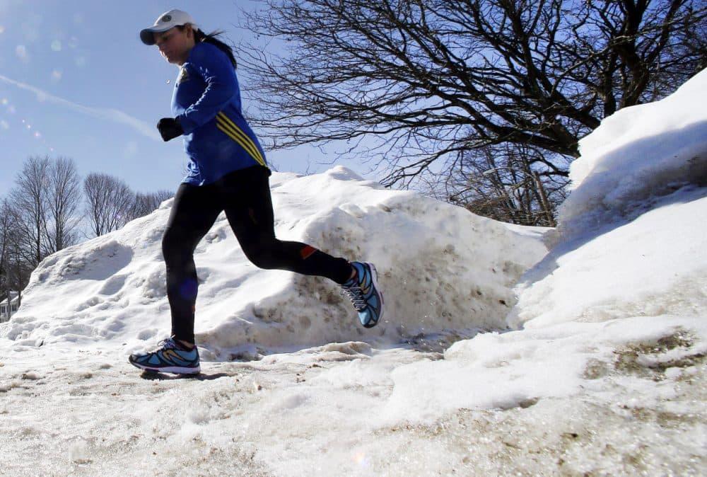 Runner Becca Pizzi, 34, trains along Heartbreak Hill in Newton. (Elise Amendola/AP)