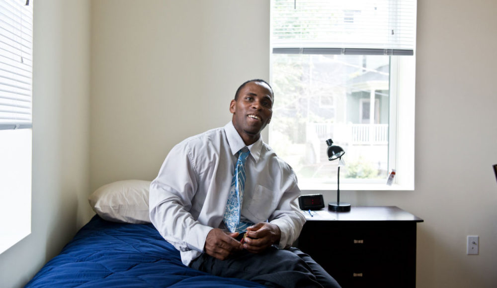Mark Mack, 36, had been homeless, on and off, for 26 years. Here he is in his new apartment in Dorchester -- the first lease he'd ever signed. (Courtesy of Laura Hajar via Pine Street Inn)
