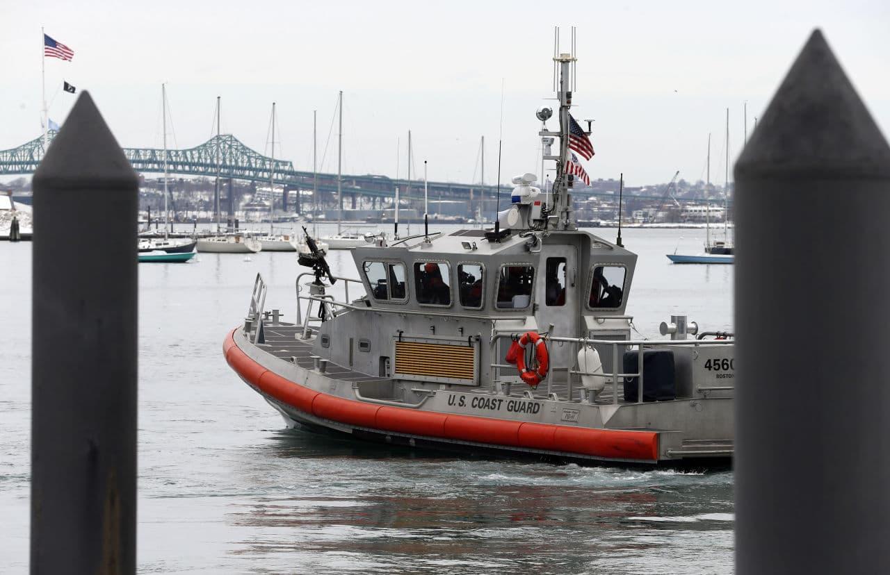 A U.S. Coast Guard vessel patrols Boston Harbor alongside federal court on Wednesday, the first day of the federal death penalty trial of Boston Marathon bombing suspect Dzhokhar Tsarnaev. (Michael Dwyer/AP)