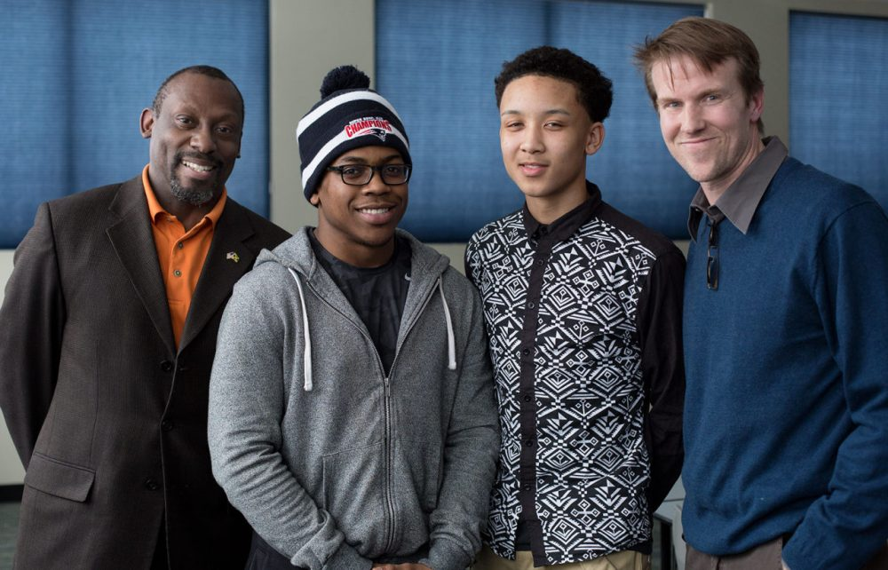 "(L-R) Neil Osborne, Max Tilus,Tyler Holness, and  Jack McGoldrick are behind  ""Statistic"" -- to change the conversation about African-American men. (Robin Lubbock/Here & Now)"