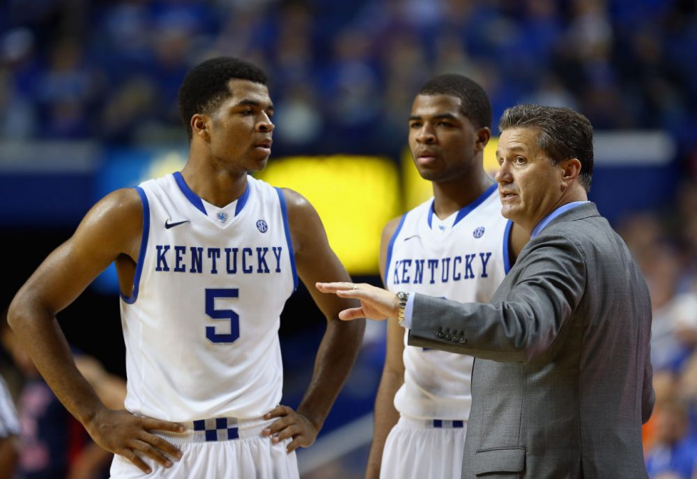 John Calipari's Kentucky Wildcats are off to a 30-0 start, thanks in part to the unexpected returns of sophomores Andrew (left) and Aaron (middle) Harrison. (Andy Lyons/Getty Images)