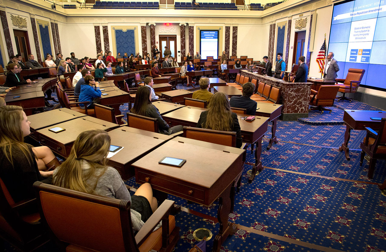 Quincy High School students participating in a mock Senate session at the Edward M. Kennedy Institute debate an amendment to an immigration reform bill. (Robin Lubbock/WBUR)