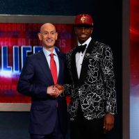 NBA Commissioner Adam Silver (left) announced Andrew Wiggins as the first overall pick in last year's draft. Wiggins was 19 years old, and had played only one college season. (Mike Stobe/Getty Images)