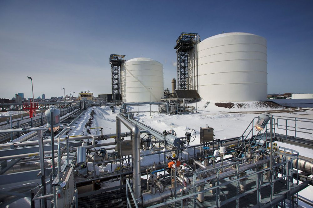 The Everett Distrigas liquefied natural gas terminal, with Boston in the background to the left. The two LNG tanks contain the equivalent amount of gas to heat and light all of Massachusetts for a day. (Jesse Costa/WBUR)