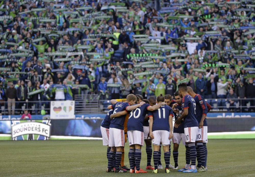 The New England Revolution opened their season in Seattle in front of 40,000 fans. (Ted S. Warren/AP)