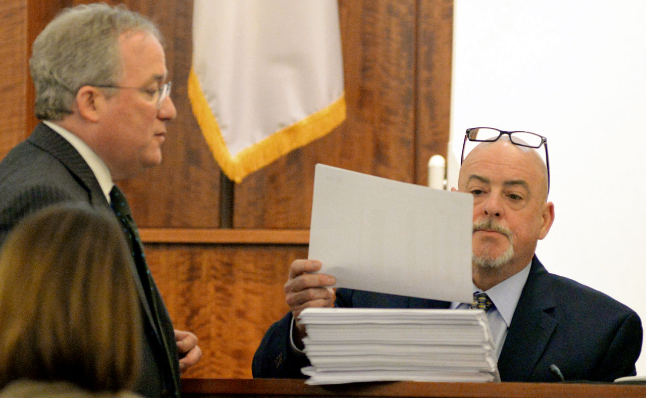 Prosecutor Patrick Bomberg (left) admits cell phone records as evidence to AT&T employee Christopher Ritchell during testimony of the trial of former New England Patriots football player Aaron Hernandez. (Faith  Ninivaggi/AP/Pool)