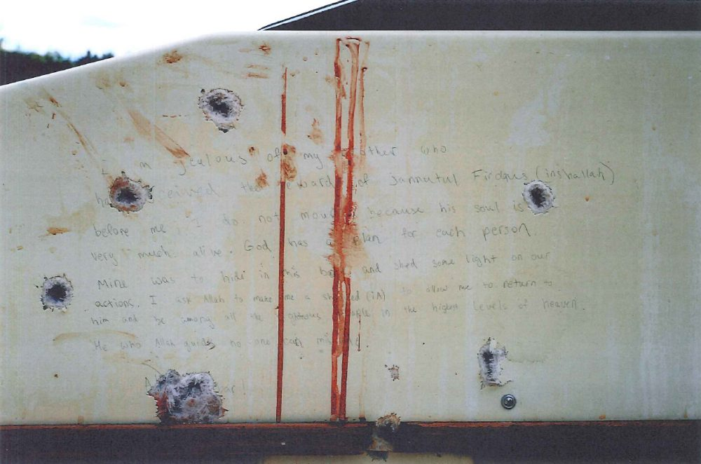 A photo of part of the handwritten note found inside the boat where Dzhokhar Tsarnaev was found hiding in Watertown. (Department of Justice)