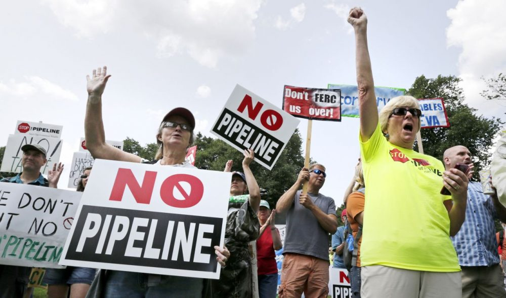 Opponents of Kinder Morgan's proposed natural gas pipeline, which was originally outlined to snake through 45 Massachusetts communities, protest on Boston Common on July 30, 2014. (Charles Krupa/AP)