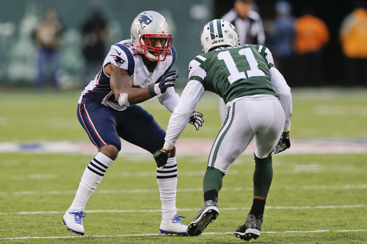 In this Dec. 21, 2014, file photo, New England Patriots cornerback Darrelle Revis (24) defends New York Jets' Jeremy Kerley (11) during NFL football game in East Rutherford, N.J. Now, he's coming back to the Jets after winning the Super Bowl with the Patriots. (Julio Cortez/AP)